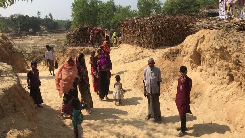 TEKNAF, BANGLADESH - APRIL 1, 2017 : The situation in the refugee camp of wooden huts rohingya Kutupalong near Cox's Bazar, Bangladesh