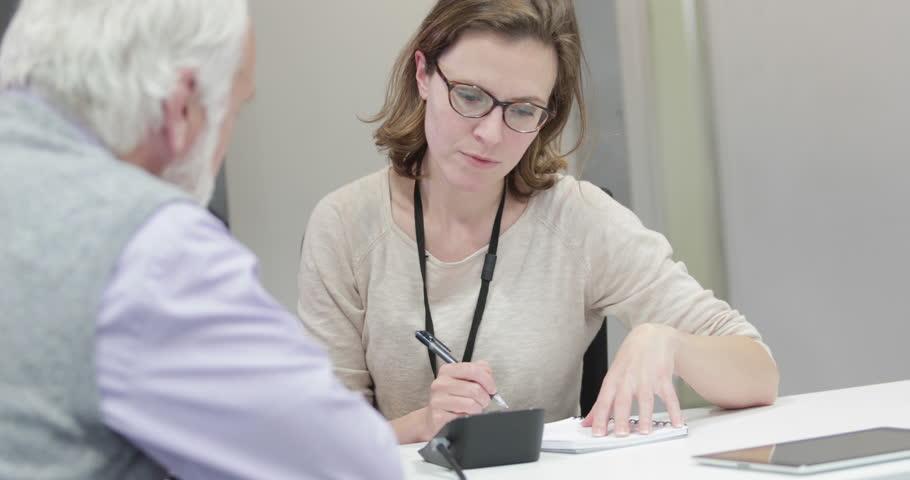Female Medical Doctor taking a Senior patients blood pressure