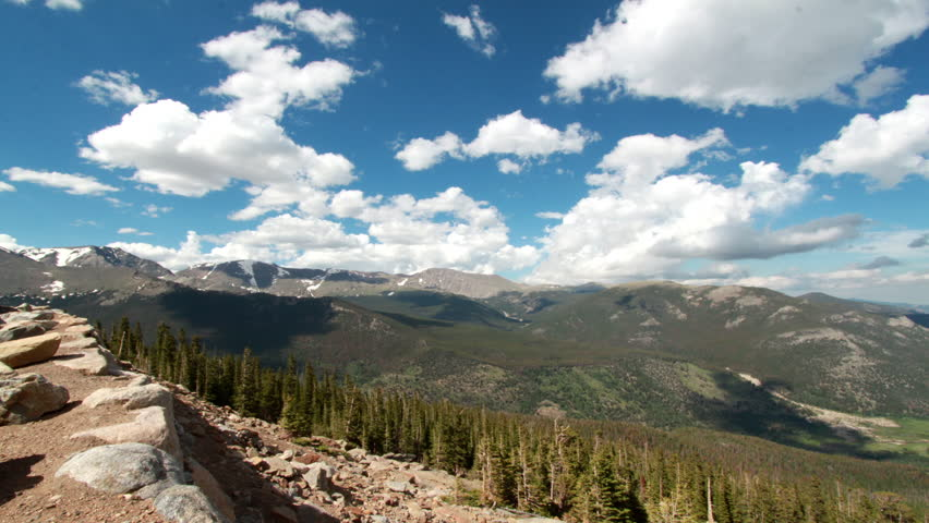 A 180 degree motion time-lapse from the peak of Rocky Mountain National Park as big puffy cumulus clouds move overhead | Shutterstock HD Video #2771201
