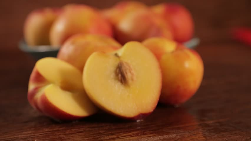 Sweet fresh nectarine dolly-shot in natural light on old wood | Shutterstock HD Video #27766279