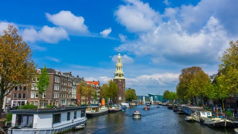 Amsterdam hyperlapse with canal houses, fast moving clouds and a tower on the background. This tower is located close to central station and the famous red light district.