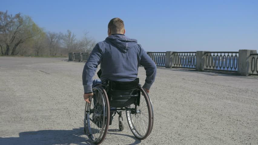 Disabled Man in Wheelchair On Vidéos de stock (100 % libres de ...