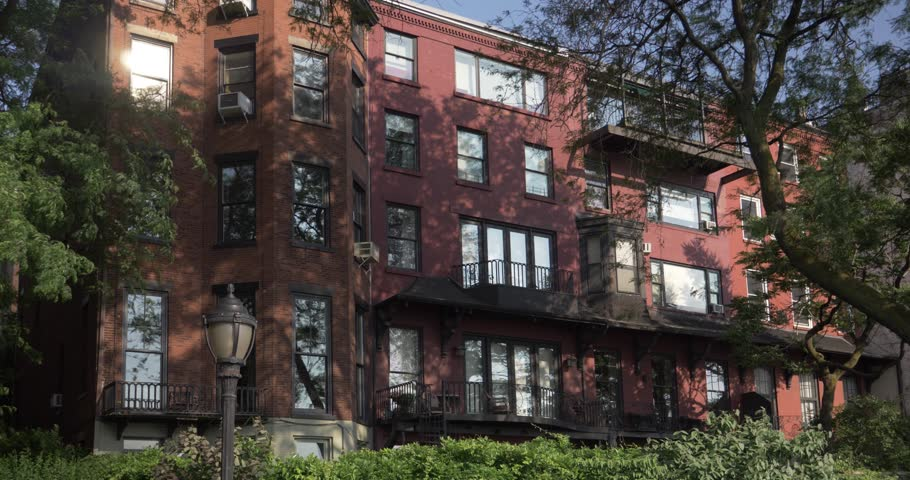 A daytime exterior establishing shot of an upscale apartment building in Brooklyn.