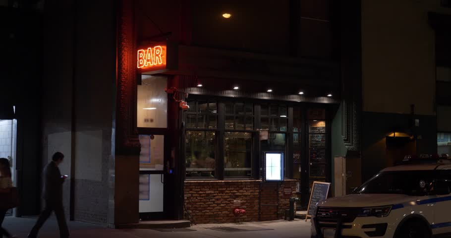 A nighttime exterior establishing shot of a bar and restaurant in downtown Manhattan, New York City.	 Day/Night matching available.