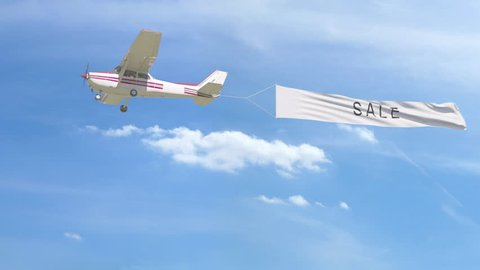 Small propeller airplane towing banner with SALE caption in the sky. 4K clip