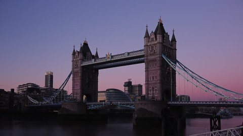 Time lapse of Tower Bridge at sunrise (London, England). Night to day a beautiful morning with clear blue skies. December 2016.