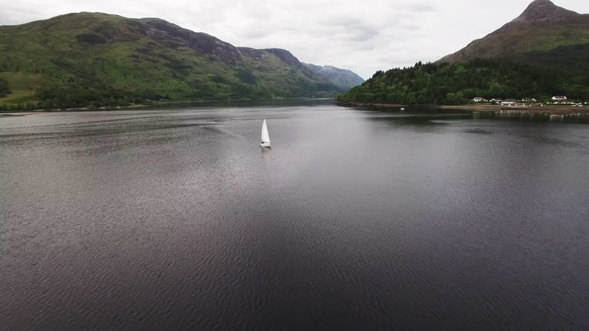 Aerial footage approaching a sail boat on loch leven near glencoe in scotland during a summer evening | Shutterstock HD Video #28030051
