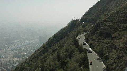 Traffic on the road to the Lanshan Mountain. Lanzhou, China.