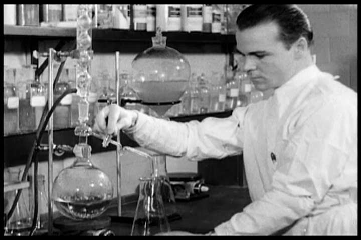 1940s: Laboratory researchers study the disease of cancer, in 1940.