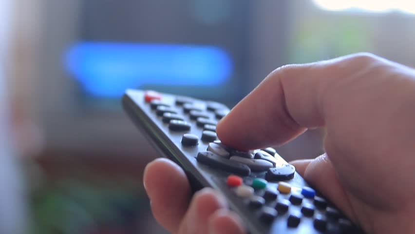 Man's hand changing channels on a tv via remote, closeup | Shutterstock HD Video #28101451