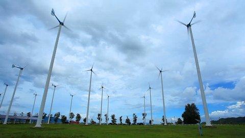 Group of wind turbines in field