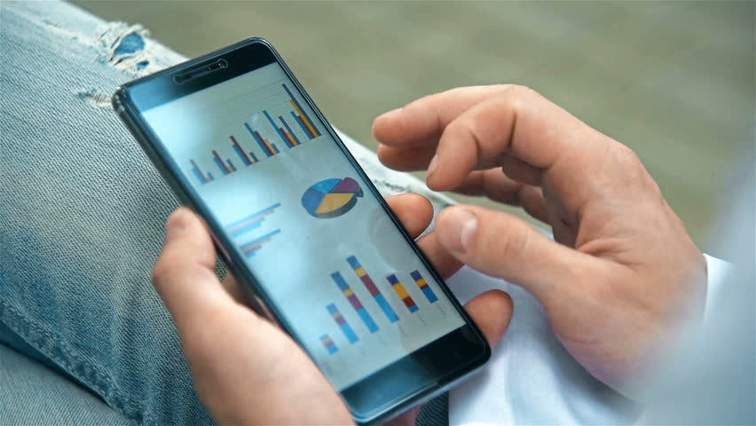 Businessman Analyzing Financial Market On Mobile Phone Screen. Business Concept | Shutterstock HD Video #28133305