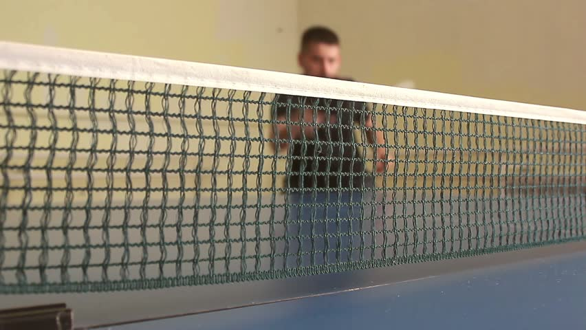 Table tennis player returning ball, focus at the net! Man warm up before a game of table tennis. | Shutterstock HD Video #28144771