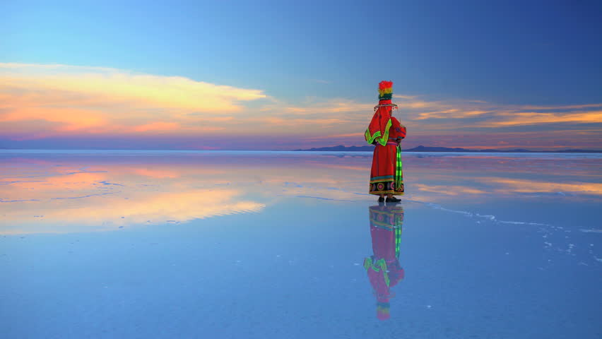 Traditionally dressed Latin American female at sunrise on the Bolivian Salar de Uyuni mineral Salt flats South America | Shutterstock HD Video #28168231