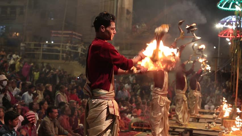 VARANASI, INDIA - JANUARY 25, 2017 : Unidentified Hindu priest at the religious Ganga Aarti ritual, fire puja, at Dashashwamedh Ghat in Varanasi, Uttar Pradesh, India