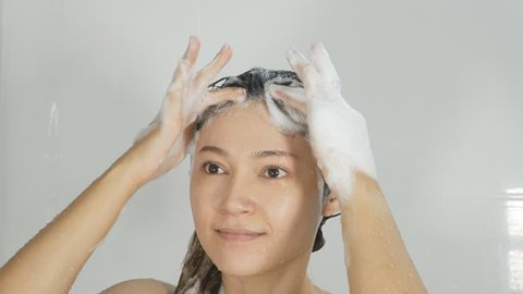 Woman Washing Hair in Shower Stock Footage Video (100%