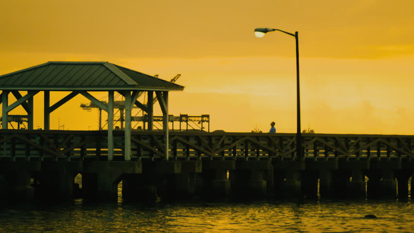 Sunrise over pier boardwalk time lapse. Tampa, Florida