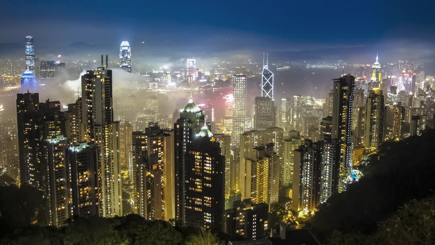 Time lapse Hong Kong skyline from famous The Peak view point at night. Wow-Effect: Clouds rushing through skyscrapers. | Shutterstock HD Video #28242304