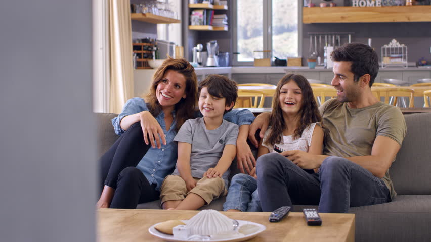 Family Sitting On Sofa In Open Plan Lounge Watching Television | Shutterstock HD Video #28273711