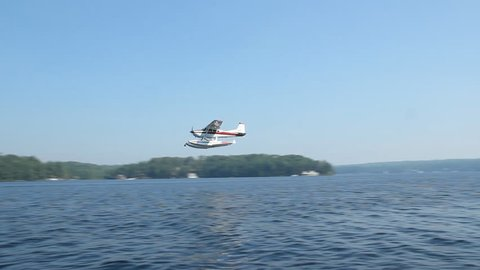 Seaplane flyby. A seaplane flying by. Lake Rosseau, Muskoka, Ontario.