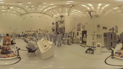 2010s: NASA engineers work on Osiris Rex deep space equipment in a highly controlled clean room environment.