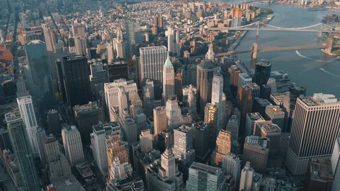 Wide angle aerial shot of new york around 6pm in the summer with  magnificent view of city skyscrapers
