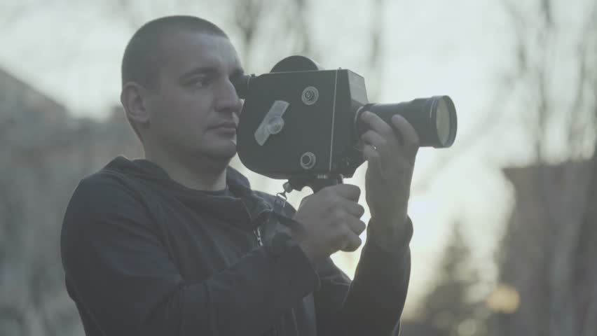Cameraman shoots a movie on an old vintage camera | Shutterstock HD Video #28363291