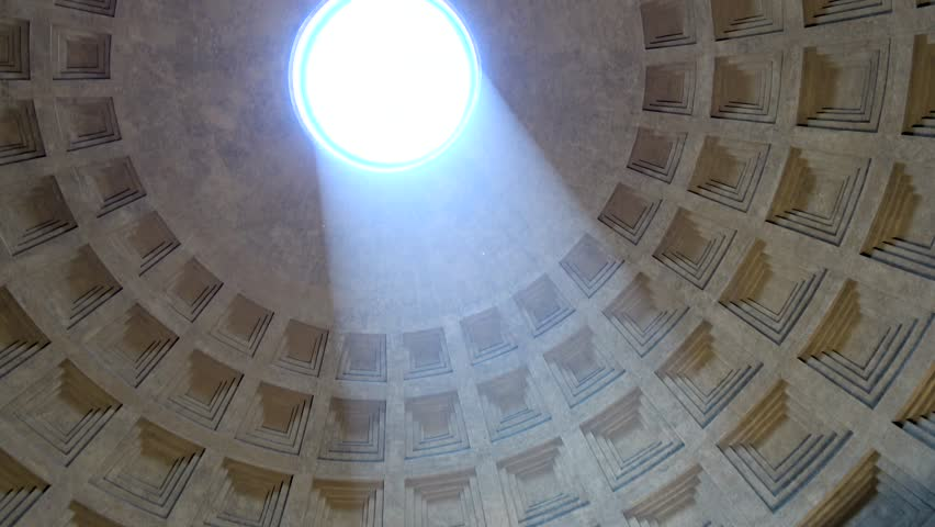 Rome Italy inside Pantheon looking up towards center of sphere hole in roof turning camera around and showing sunlight falling into temple to gods of ancient Rome now Roman Catholic church building 4k