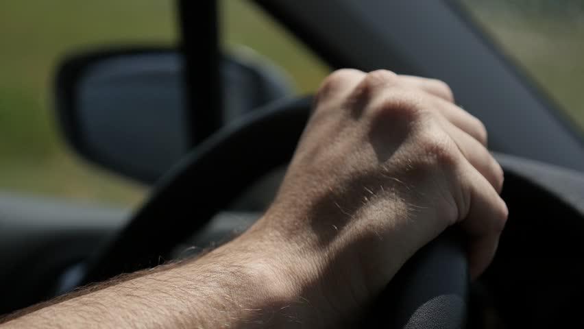Feeling brand new car slow motion 1080p FullHD footage - Male hands on brand new vehicle steering wheel slow-mo 1920X1080 HD video   Shutterstock HD Video #28379650
