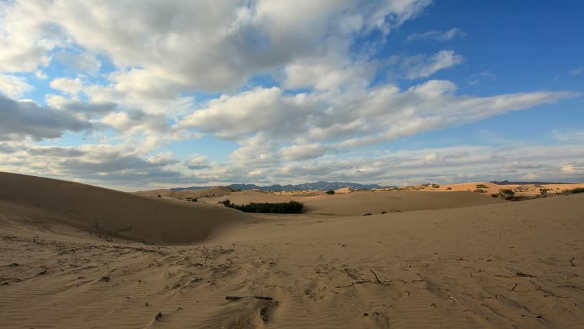4K. Clouds over a dune in the Gobi Desert, Mongolia