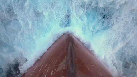 Splash of a sea wave against ship's bow.