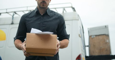 Delivery man delivering package to customer, close up at and and box