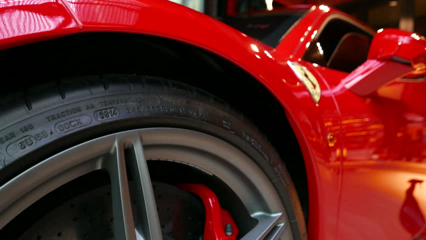 close up of Red Ferrari F430 Scuderia Front Wheel brake system with logotype. at Bangkok, Thailand, July 2017 ; editorial use only