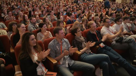 Novosibirsk Russia - May 20 2017: Listeners clap on learning conference or culture show. Leisure or convention for discussion. All seats are busy in large hall for look. Studying management of company