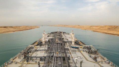Oil tanker is proceeding through Suez Canal.