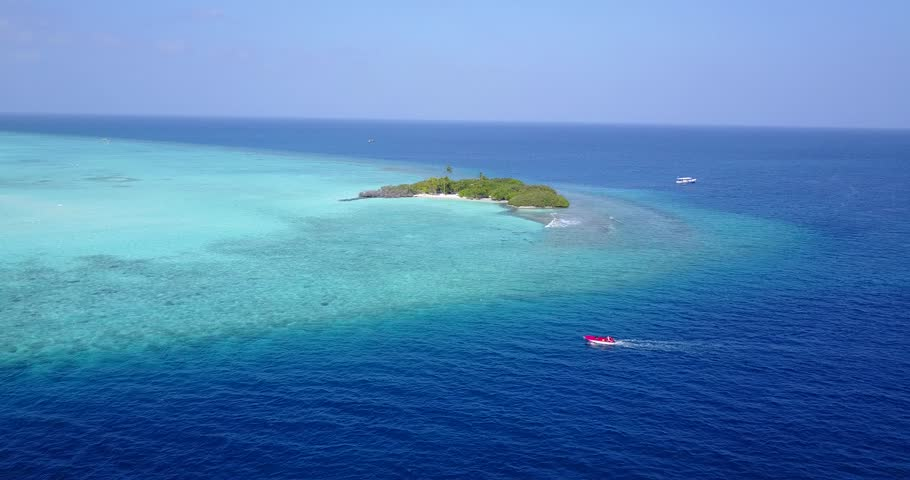V05339 Aerial flying drone view of Maldives white sandy beach on sunny tropical paradise island with aqua blue sky sea water ocean 4k | Shutterstock HD Video #28512409