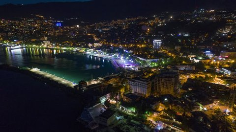 Flying over the seafront of Yalta, the sea port, the feast day of Russia, stage, concert, a lot of people, the road sweeping cars.
