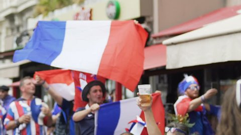 MARSEILLE, FRANCE - JUNE 15, 2016: UEFA EURO 2016. Football fans before France vs Albania game. Pleased football fans wearing funny headgear and waving flags of France, match