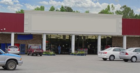 A daytime exterior DX establishing shot of an unbranded, generic grocery store. Blank marquee for customization.