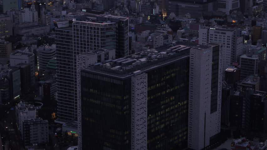 Japan Tokyo Aerial v63 Shinjuku birdseye view flying low panning up to downtown cityscape dusk 2/17 | Shutterstock HD Video #28603891