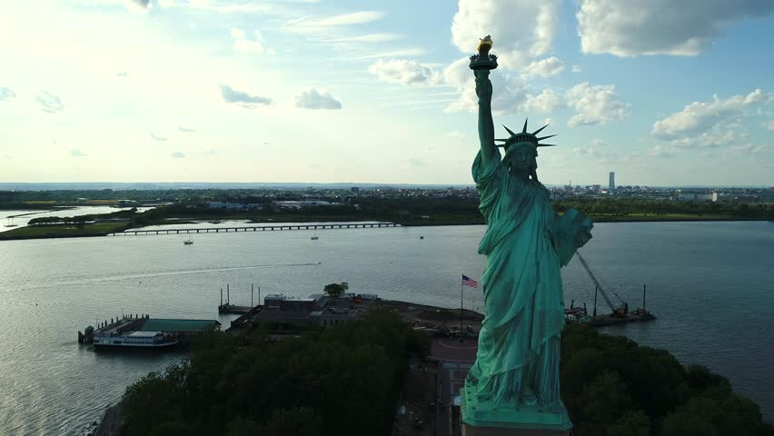 Aerial drone orbit Statue of Liberty reveal New York City | Shutterstock HD Video #28606891