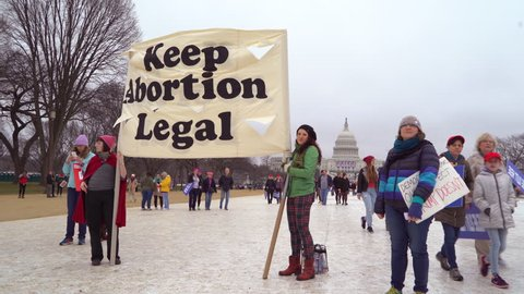 Washington D.C.-2010s: Pro abortion activists hold a sign in Washington DC to keep abortion legal.