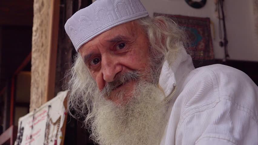 Bosnia Herzegovina-2010s: An old Bosnian Muslim man looks at the camera.   Shutterstock HD Video #28639228