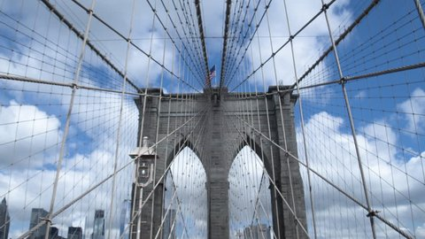 Architecture and engineering. The unique design of the Brooklyn bridge in New York. Dolly shot