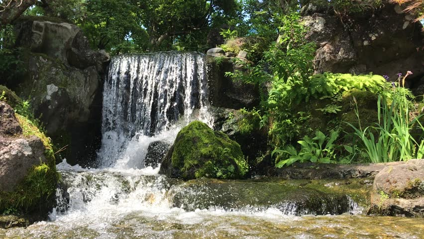 Japanese garden waterfall, the waterfalls in the garden of Nishikigoi no Sato, the Koi Museum in Ojiya, Japan, the birthplace of Nishikigoi.