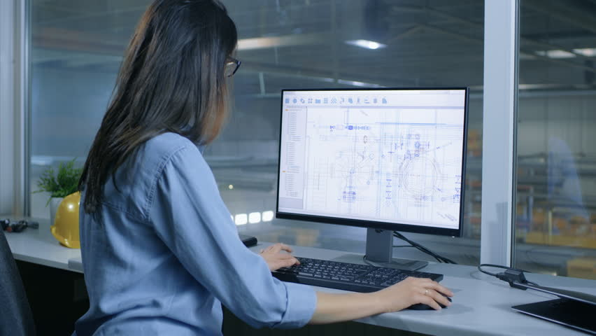 Female Industrial Engineer Working With Technical Blueprints on Her Personal Computer. Inside of the Factory is Seen From Her Office Window. Shot on RED EPIC-W 8K Helium Cinema Camera. | Shutterstock HD Video #28698364