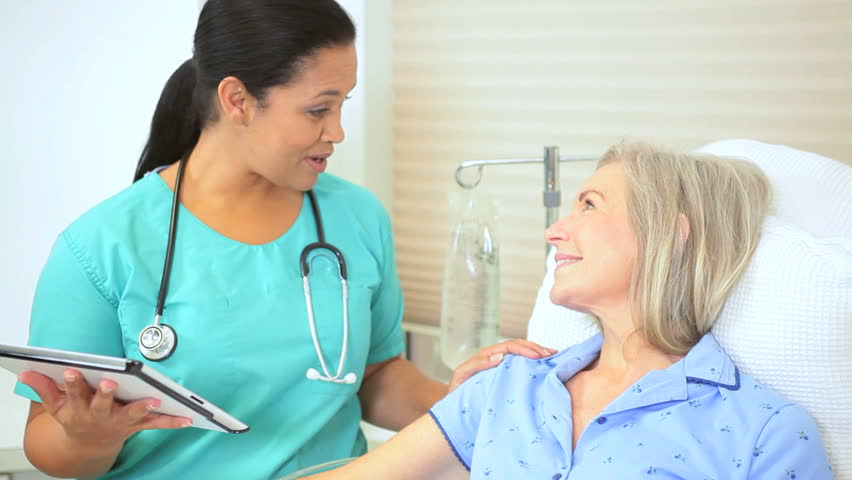 Medical staff using tablet for care plan senior female patient | Shutterstock HD Video #2870056