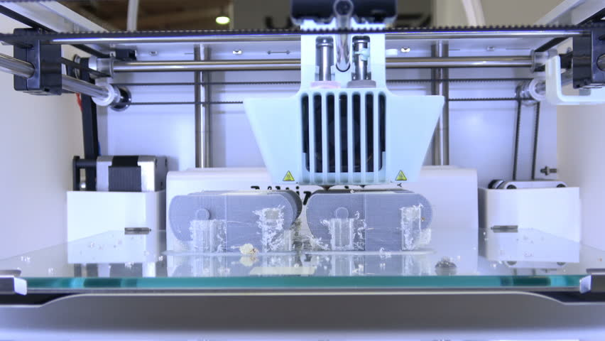 Hannover, Germany - March, 2017: 3d printer iGo 3d Ultimaker printing close up process on exhibition Cebit 2017 in Hannover Messe, Germany | Shutterstock HD Video #28704721