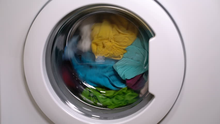 Washing machine is washing clothes