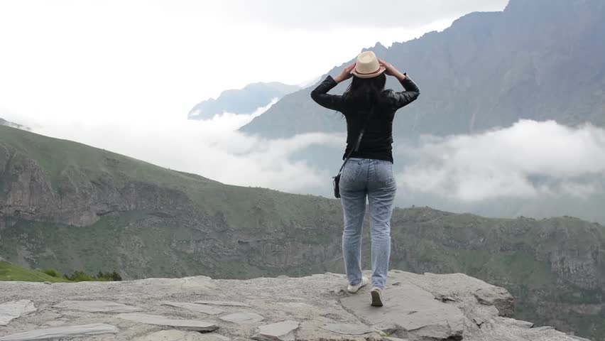 Girl admires mountains, vacation in mountains. | Shutterstock HD Video #28746451